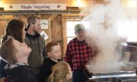 A family learns how sap turns into syrup.jpg
