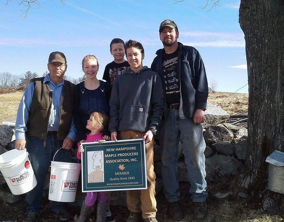 5 generation Abbott Farm in Moultonborough with their new NHMPA sign