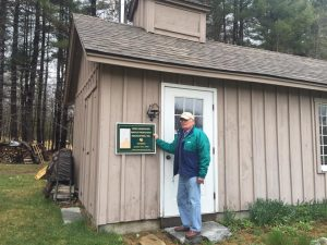 Don Upton of Monadnock Sugarhouse in Trpy with his new sign