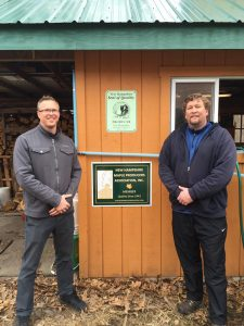 Tim Sullivan and Jason Demeroto of NH DHHS's Sununu Center with their new sign