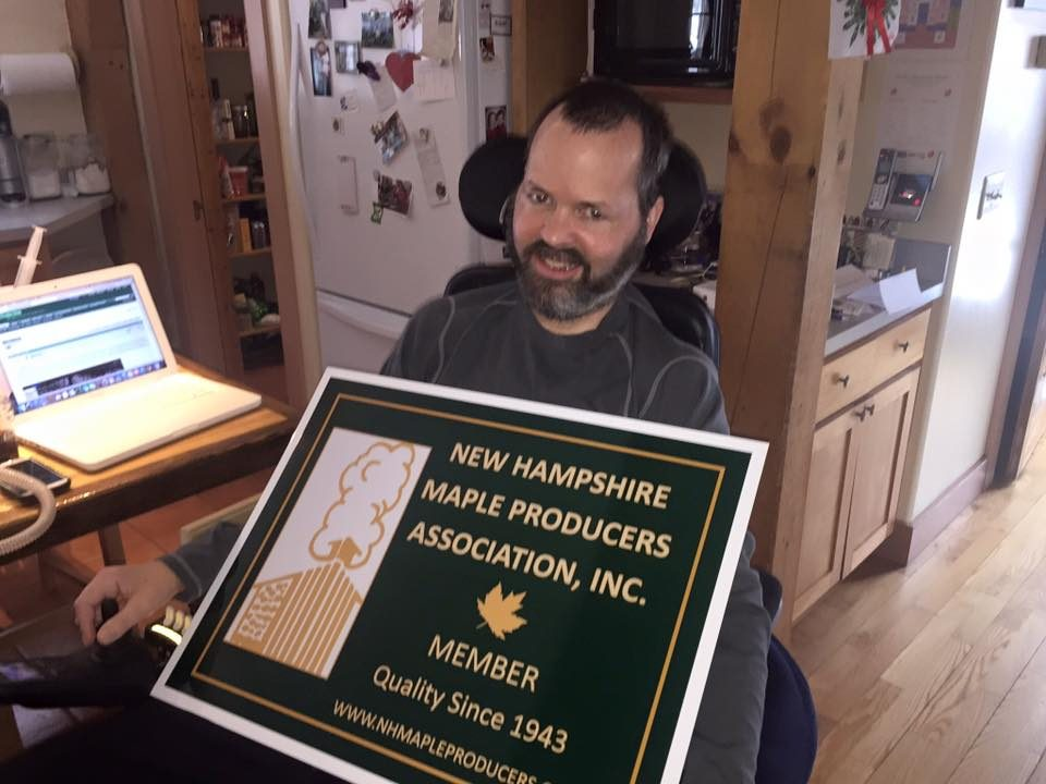 ric Johnson of Tucker Mountain Maples proudly displaying his new NHMPA sign