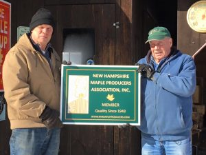 The first new NHMPA sign delivered to long time members Dean and Meg Wilber at Maple Tree Farm in Concord NH